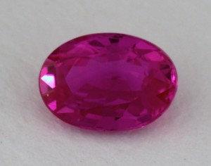 1.05 Carat Oval Cut Ruby with Purplish Hue for $980