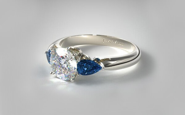diamond engagement ring centerpiece with pear shaped blue sapphire set in 14k white gold