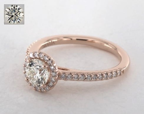 0.63 carat halo engagement ring in 14K rose gold for $2,500