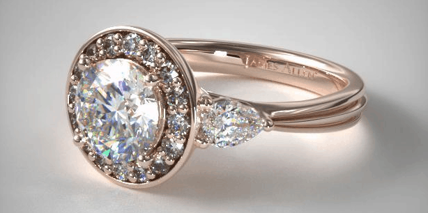 halo with pear shape side stones and carved band