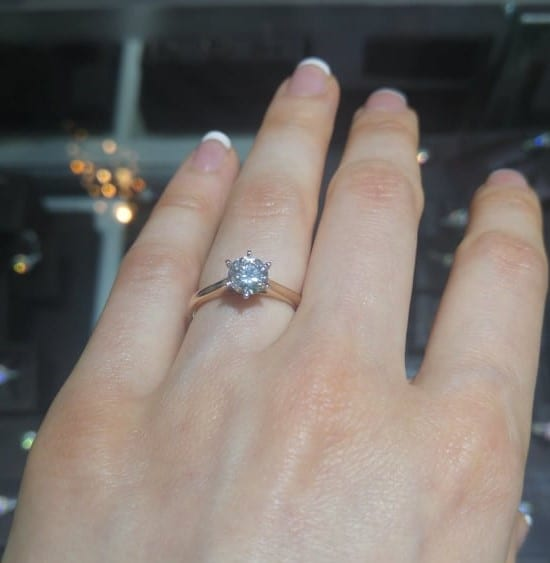 engagement ring on left hand