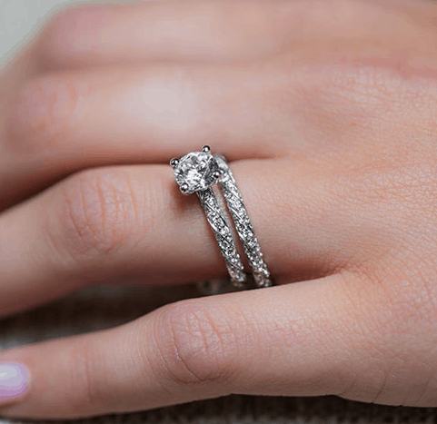 engagement and wedding rings on left hand
