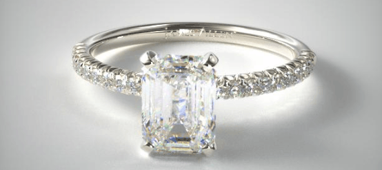 pave setting with an emerald cut center diamond