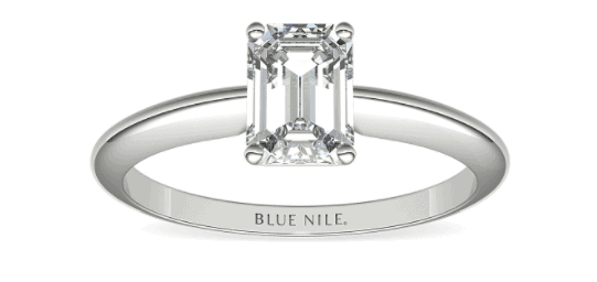 Solitaire setting with emerald cut center diamond